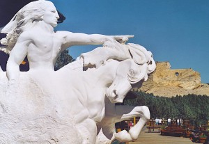 Crazy Horse Memorial: model in foreground, mountain sculpture taking shape